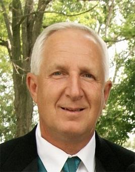 Steve J. Chevalier portrait in a suit outside