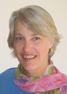 Charlotte Danard portrait in a pink scarf and blue shirt