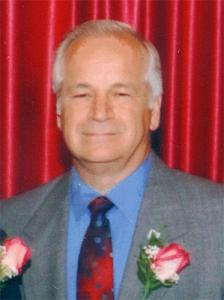 Frank Cirone portrait in front of red background