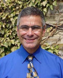 Jack Koenka portrait outside in front of wall