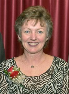 Myrna Ingalls portrait in front of red background